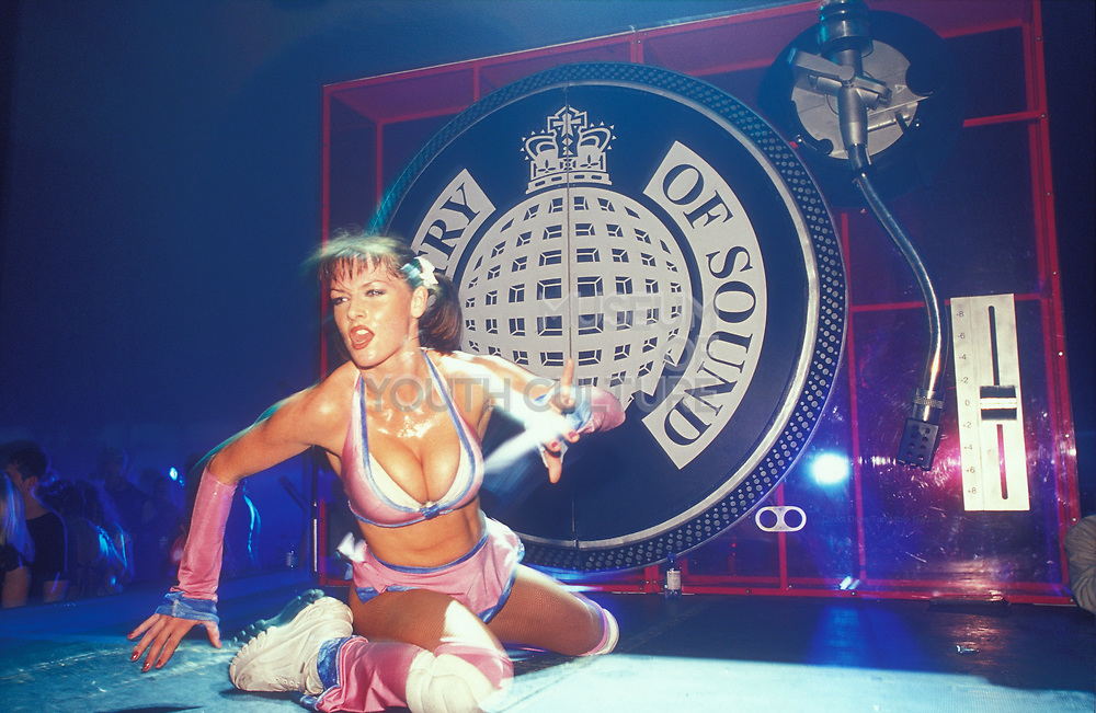 A dancer performs at Ministry of Sound, Millenium Dome, New Years Eve, U.K,  2001.