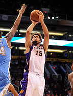 Oct. 22 2010; Phoenix, AZ, USA; Phoenix Suns forward-center Robin Lopez (15) puts up a shot during the first half against Denver Nuggets forward-center Melvin Ely (34) during a preseason game at the US Airways Center. The Nuggets defeated the Suns 144 - 106. Mandatory Credit: Jennifer Stewart-US PRESSWIRE.