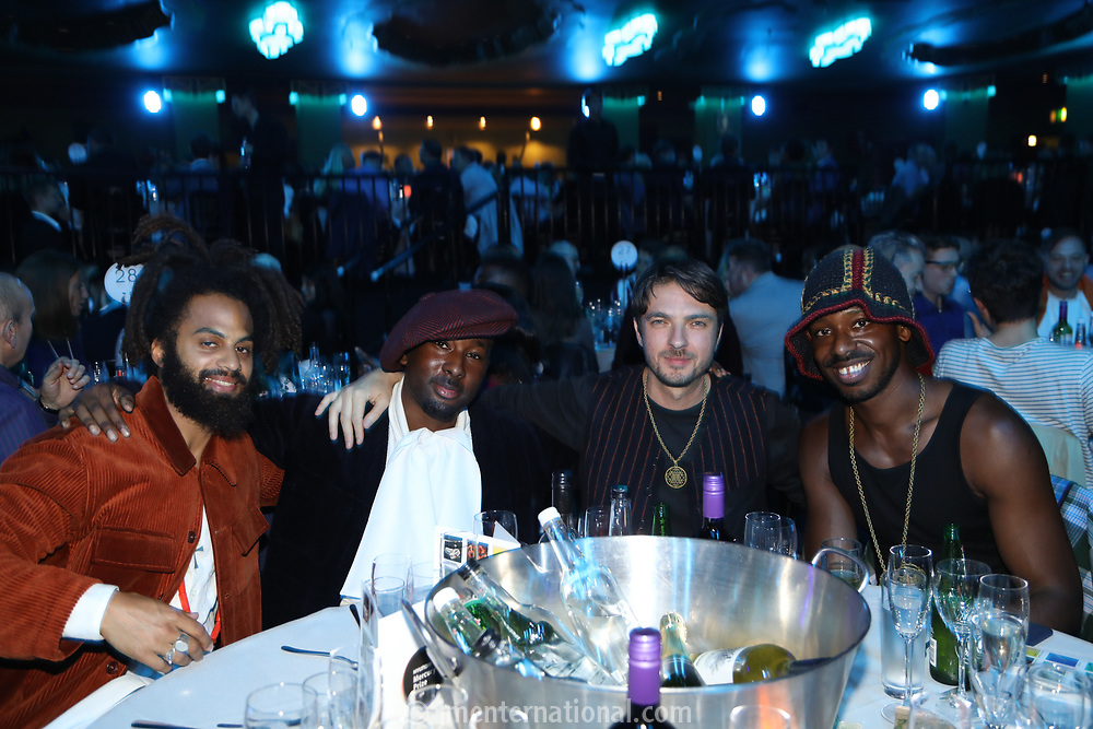 Sons of Kemet at their awards drinks table