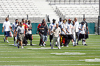 21 August 2008: Head Coach Pete Carroll walks with players in street school clothes onto the field before the USC Trojans Pac-10 NCAA College football team final intrasquad scrimmage of fall camp in front of 8,000 fans in the Los Angeles Memorial Coliseum near school campus.  White team (1st and 2nd teamers) defeated the Cardinal (reserves) team 28-7 on Thursday.