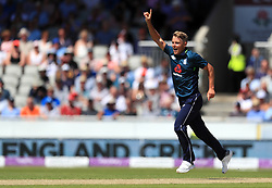 England's Sam Curran celebrates taking the wicket of Australia's Ashton Agar during the One Day International match at Emirates Old Trafford, Manchester.