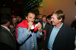 LIVERPOOL, ENGLAND - WEDNESDAY, JUNE 9th, 2005: Tennis Legend Henri Leconte celebrates with Liverpool FC Legend Kenny Dalglish after winning the auction for his shirt during the Players Party at the St Thomas Hotel during the 4th Liverbird Developments Liverpool International Tennis Tournament. (Pic by Dave Rawcliffe/Propaganda)
