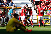Swindon Town players celebrate a goal (1-0) during the EFL Sky Bet League 2 match between Swindon Town and Macclesfield Town at the County Ground, Swindon, England on 14 September 2019.
