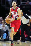 March 23, 2010; Cleveland, OH, USA; New Jersey Nets shooting guard Sasha Vujacic (20) looks for a pass as he makes his way down court during the first quarter against the Cleveland Cavaliers at Quicken Loans Arena. Mandatory Credit: Jason Miller-US PRESSWIRE