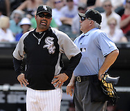 CHICAGO - JULY 10:  Manager Ozzie Guillen #13 of the Chicago White Sox argues with home plate umpire Larry Vanover #27 during the game against the Minnesota Twins on July 10, 2011 at U.S. Cellular Field in Chicago, Illinois.  The Twins defeated the White Sox 6-3.  (Photo by Ron Vesely)  Subject: Ozzie Guillen;Larry Vanover