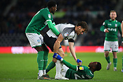 Derby County forward Chris Martin (19) offers a helping and to Sheffield Wednesday defender Moses Odubajo (22) during the EFL Sky Bet Championship match between Derby County and Sheffield Wednesday at the Pride Park, Derby, England on 11 December 2019.