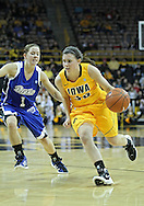 December 20, 2011: Iowa Hawkeyes guard Kathryn Reynolds (33) drives around Drake Bulldogs guard Carly Grenfell (1) during the NCAA women's basketball game between the Drake Bulldogs and the Iowa Hawkeyes at Carver-Hawkeye Arena in Iowa City, Iowa on Tuesday, December 20, 2011. Iowa defeated Drake 71-46.