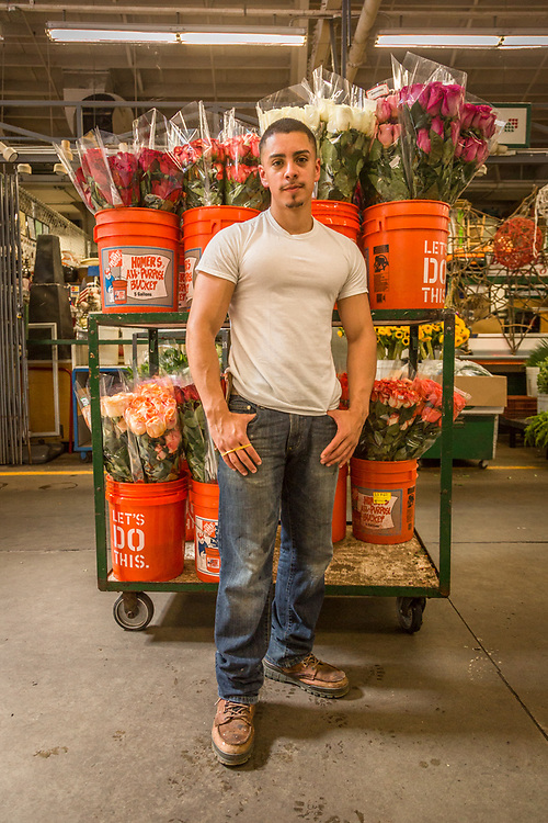 """I've been working here since I was 10.""  -Twenty year old business management student Mario Gonalez takes a break at his family's flower business at the San Francisco Flower Market."