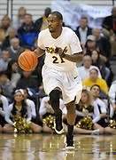 Feb 19, 2011; Long Beach, CA, USA; Long Beach State 49ers guard Larry Anderson (21) dribbles the ball against the Montana Grizzlies at the Walter Pyramid. Long Beach State defeated Montana 74-56.