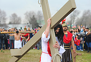 Roberto Marquez, of Bensalem, Pennsylvania portrays Jesus as he carries a cross during the Stations of the Cross leading to his crucifixion on Good Friday April 3, 2015 at Our Lady of Fatima in Bensalem, Pennsylvania.  (Photo by William Thomas Cain/Cain Images)