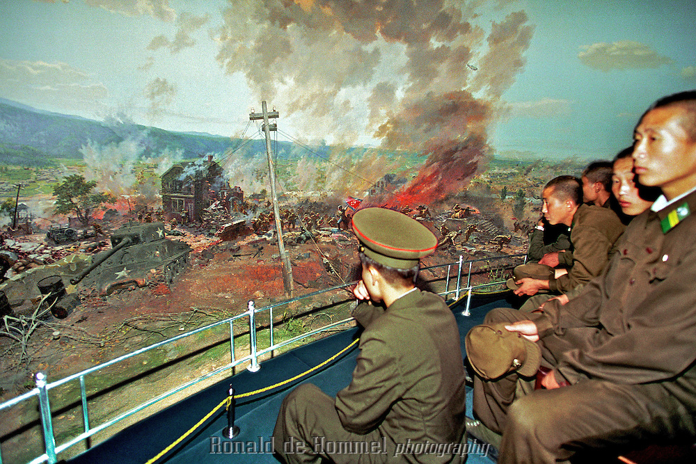 Soldiers visit a Panorama depicting one of the most famous battles in the Korean war. It's a 360 degree panorama. The central platform rotates. Koran War museum Pyonyang North Korea july 2001