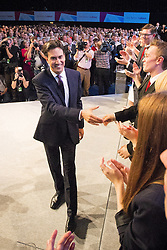 © Licensed to London News Pictures . 24/09/2013 . Brighton , UK . The Labour Party Leader , Ed Miliband , shakes hands with the audience after delivering the Leader's Speech to the conference , this afternoon (24th September 2013) . Day 3 of the Labour Party Conference in Brighton . Photo credit : Joel Goodman/LNP