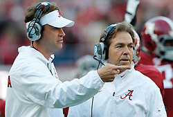 Nov 15, 2014; Tuscaloosa, AL, USA; Alabama Crimson Tide head coach Nick Saban and offensive coordinator Lane Kiffen talk during the game against Mississippi State Bulldogs at Bryant-Denny Stadium. Mandatory Credit: Marvin Gentry