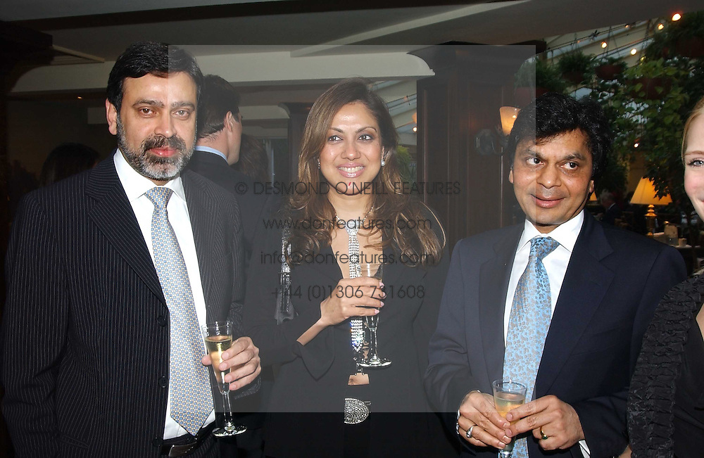 Left to right, NADEEM &amp; VANITA AHMED and BIPIN DESAI at a fundraising dinner for the charity 'Elephant Family' held at The Bombay Brasserie, Gloucester Road, London on 26th April 2005.<br />