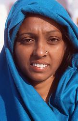 Portrait of woman wearing traditional dress,