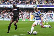 Queens Park Rangers Defender Jake Bidwell (3) puts in a cross with Bolton Wanderers forward Sammy Ameobi (10) putting him under pressure during the EFL Sky Bet Championship match between Queens Park Rangers and Bolton Wanderers at the Loftus Road Stadium, London, England on 30 March 2019.