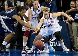 March 29, 2010; Sacramento, CA, USA; Stanford Cardinal guard JJ Hones (10) and Xavier Musketeers center Ta'Shia Phillips (53) fight for a loose ball during the first half in the finals of the Sacramental regional in the 2010 NCAA womens basketball tournament at ARCO Arena. Stanford defeated Xavier 55-53.
