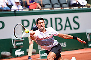 Novak Djokovic (SRB) at full stretch during the preliminary rounds of the Roland Garros Tennis Open 2017 at Roland Garros Stadium, Paris, France on 2 June 2017. Photo by Jon Bromley.