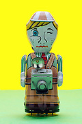 photographer metal toy figurine