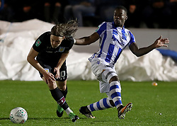 Aston Villa's Birkir Bjarnason (left) and Colchester United's Ryan Jackson battle for the ball during the Carabao Cup, First Round match at the Weston Homes Community Stadium, Colchester.