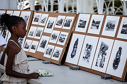 "Kelley Neptune, 9, studies the historic images of the Mini-Coaling exhibit contributed by Jane & Mike Sheen.  7th Annual Dollar Fo' Dollar Culture & History Tour & MIni Coaling Exhibit.  A remebrance of the 1892 Coal Workers Strike on St. Thomas ""livicated"" to Ras Jahstarr Koniyah.  Held annually in September, the tour celebrates the successful protest of 19th centry coal laborers in the streets of downtown Charlotte Amalie for better pay.  Mary Ann Christopher plays the role of Queen Coziah who led the successful revolt.  © Aisha-Zakiya Boyd"