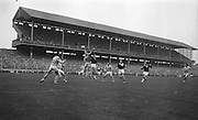 Dublin's full back Foley fists the ball pressed by Galway's Cleary during the All Ireland Senior Gaelic Football Championship Final Dublin v Galway in Croke Park on the 22nd September 1963. Dublin 1-9 Galway 0-10.
