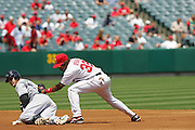 ANAHEIM, CA - APRIL 26:  Second baseman Erick Aybar #32 of the Los Angeles Angels of Anaheim tries to put a tag on Rocco Baldelli #5 of the Devil Rays at second base during the game against the Tampa Bay Devil Rays at Angel Stadium in Anaheim, California on April 26, 2007. The Angels defeated the Devil Rays 11-3. ©Paul Anthony Spinelli *** Local Caption *** Erick Aybar;Rocco Baldelli
