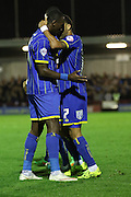 Ade Azeez of AFC Wimbledon celebrates with team after scoring, during the Sky Bet League 2 match between AFC Wimbledon and Northampton Town at the Cherry Red Records Stadium, Kingston, England on 29 September 2015. Photo by Stuart Butcher.