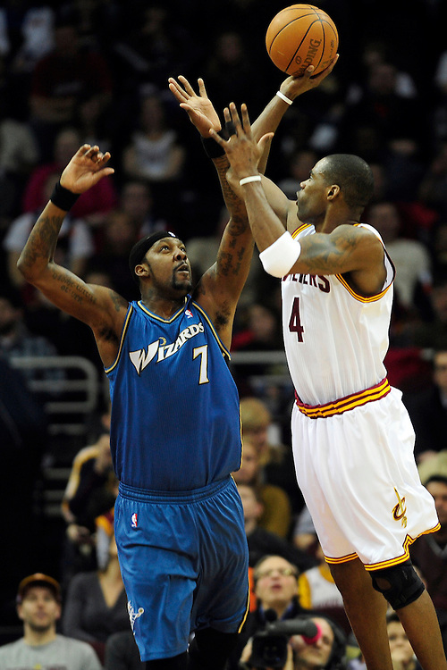 Feb. 13, 2011; Cleveland, OH, USA; Cleveland Cavaliers power forward Antawn Jamison (4) shoots over Washington Wizards power forward Andray Blatche (7) during the first quarter at Quicken Loans Arena. Mandatory Credit: Jason Miller-US PRESSWIRE