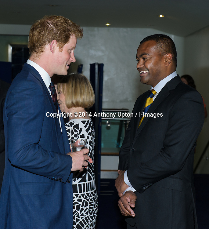 Image ©Licensed to i-Images Picture Agency. 10/06/2014. London, United Kingdom. HRH Prince Harry attends the 50th Anniversary of Zulu premiere. . Picture by Anthony Upton / i-Images<br /> Leicester Square, London, 10 June 2014: HRH Pr. Harry with Lord Ashcroft with Lt. Chard's and Lt. Bromhead's original VC's at a gala screening to celebrate the 50th Anniversary of Zulu where guests were joined by Prince Harry to watch a digitally remastered version of the iconic film. The evening was arranged to raise money for two charities supported by Prince Harry, Walking With The Wounded and Sentebale. <br /> For further info please contact<br /> Emily Conrad-Pickle Captive Minds<br /> Mobile: +44 (0)7799 414 790<br /> emily.conrad-pickles@captiveminds.com