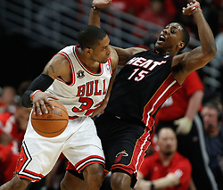 15.05.2011, UNITED CENTER, CHICAGO, USA, NBA, Chicago Bulls vs Miami Heat, im Bild C.J. Watson (L) and Miami Heat guard Mario Chalmers (R)in game 1 of the NBA Eastern Conference Championships at the United Center in Chicago, EXPA Pictures © 2011, PhotoCredit: EXPA/ Newspix/ KAMIL KRZACZYNSKI +++++ ATTENTION - FOR AUSTRIA/ AUT, SLOVENIA/ SLO, SERBIA/ SRB an CROATIA/ CRO, SWISS/ SUI and SWEDEN/ SWE CLIENT ONLY +++++