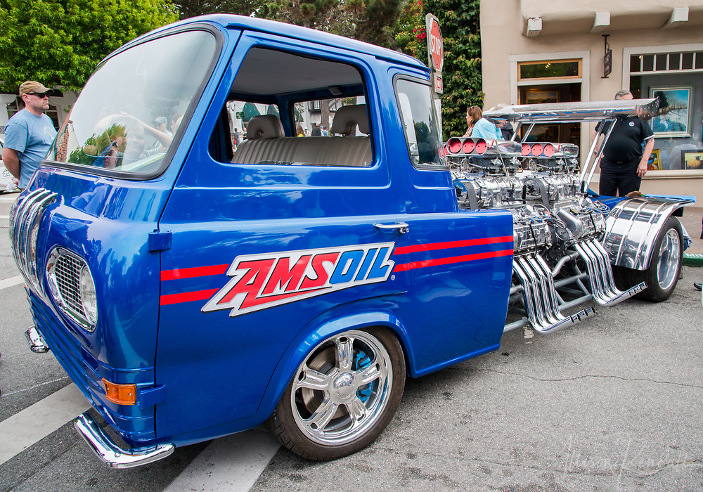 A Ford Econoline heavily modified with several motors  on display at the 2017 Carmel-by-the-Sea Concours on the Avenue