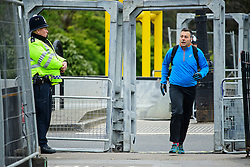 © London News Pictures. 22/04/2016. London, UK. A jogger in Regents Park runs through security gates. Heightened security surrounding the residence of the US Ambassador to the United Kingdom in Regents Park, London, where the President of the United States Barak Obama is staying during his visit to the UK. Photo credit: Ben Cawthra/LNP