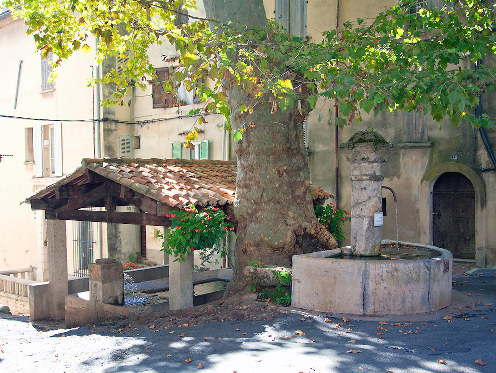 The water from the Fontaine Capitaine Vincens feeds an adjacent wash house in Barjols in the Var region of southern France.  This town is noted for its numerous fountains, wash houses, and old tanneries, a town shaped by water since Roman times.