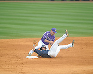 Ole Miss' Tanner Mathis (12) steals second base vs. Lipscomb's Noah Chandler (21) at Oxford-University Stadium in Oxford, Miss. on Saturday, March 9, 2013. Ole Miss won 8-5. The win was the 486th for Mike Bianco as the Rebel head coach, making him the university's all time winningest baseball coach.