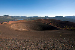 Crater and rim of Cinder Cone with Butte Lake in background, Lassen Volcanic National Park, California, United States of America