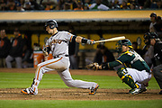 San Francisco Giants designated hitter Buster Posey (28) strikes out swinging against the Oakland Athletics at Oakland Coliseum in Oakland, California, on July 31, 2017. (Stan Olszewski/Special to S.F. Examiner)