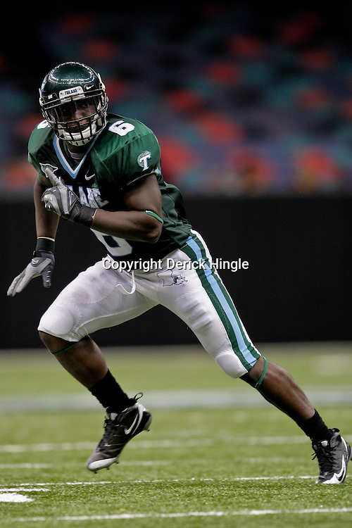 Sep 26, 2009; New Orleans, LA, USA; Tulane Green Wave linebacker Travis Burks (6) in pass coverage against the McNesse State Cowboys at the Louisiana Superdome. Tulane defeated McNeese State 42-32. Mandatory Credit: Derick E. Hingle-US PRESSWIRE