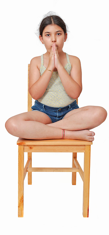 Young girl of 9 meditating Model release available