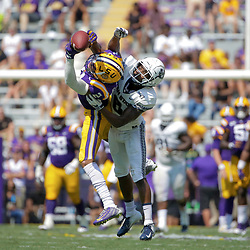Oct 5, 2019; Baton Rouge, LA, USA; LSU Tigers wide receiver Justin Jefferson (2) catches a pass over Utah State Aggies cornerback Cameron Haney (6) during the first half at Tiger Stadium. Mandatory Credit: Derick E. Hingle-USA TODAY Sports