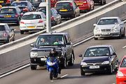 Motorcyclist in front of traffic on M25 motorway, near London, United Kingdom