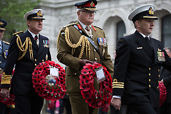 The Anzac Day tradition -WW1 memorial. Representative of the  Arm forces and ex-service organisations  hold wreaths during the ANZAC day at The Centotaph in a service of remembrance. Whitehall, London, United Kingdom. Friday, 25th April 2014. Picture by Daniel Leal-Olivas / i-Images