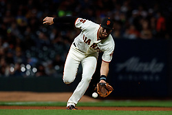 SAN FRANCISCO, CA - JUNE 12: Evan Longoria #10 of the San Francisco Giants fields a ground ball against the San Diego Padres during the seventh inning at Oracle Park on June 12, 2019 in San Francisco, California. The San Francisco Giants defeated the San Diego Padres 4-2. (Photo by Jason O. Watson/Getty Images) *** Local Caption *** Evan Longoria