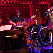 December 4, 2012 - New York, NY : Actor and singer Darius de Haas, far right, performs at the nightclub 54 Below in Manhattan on Tuesday evening with, from left, pianist Michael Mitchell, bassist George Farmer, and guitarist Marvin Sewell. Drummer Kenneth Salters is not visible.  CREDIT: Karsten Moran for The New York Times