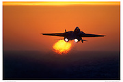 F-14A in full afterburner at sunset
