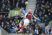 Brighton and Hove Albion forward Glenn Murray (17) battles in the air with West Ham United defender James Collins (19) during the Premier League match between Brighton and Hove Albion and West Ham United at the American Express Community Stadium, Brighton and Hove, England on 3 February 2018. Picture by Phil Duncan.