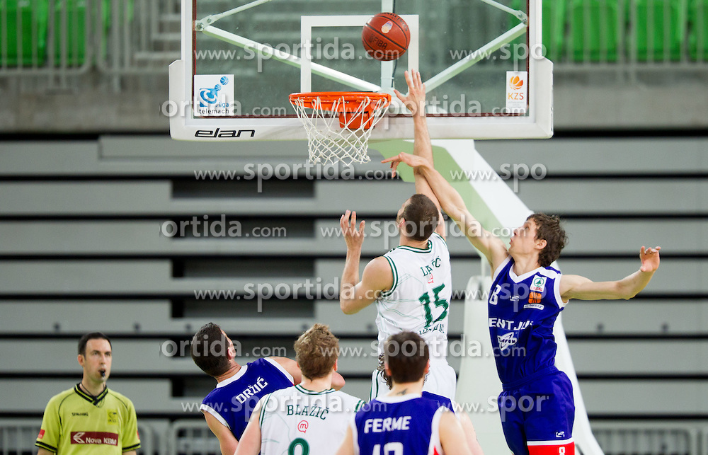 Vladimir Dasic of Olimpija vs Milan Sebic of Sentjur during basketball match between KK Union Olimpija and KK Sentjur in 4th Round of Telemach League for Slovenian National Champion 2011/12, on April 4, 2012, in Arena Stozice, Ljubljana, Slovenia. (Photo by Vid Ponikvar / Sportida.com)