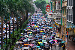 Hong Kong. 6 October 2019. Tens of thousands of pro-democracy protestors march in pouring rain through centre of Hong Kong today from Causeway Bay to Central. Peaceful march later turned violent as a hard-core of protestors confronted police. Pic; sea of umbrellas in during rain. Iain Masterton/Alamy Live News.