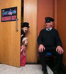 THIS YEARS LATE LATE TOY SHOW PROMISES TO BE SUPERCALIFRAGILILSTICEXPIALIDOCIOUS&hellip;. <br /> RTE Security Guard Tom Clarke guards the secret set of this year&rsquo;s Late Late Toy with Sam Kirwan (8) Navan and Emily Talbot (5) from Navan and it promises to be supercalifragililsticexpialidocious! The theme of this year&rsquo;s show is based on the much loved musical film Mary Poppins. Picture Andres Poveda