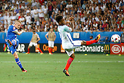 Iceland defender Ari Freyr Skúlason (23) has a shot on goal during the Round of 16 Euro 2016 match between England and Iceland at Stade de Nice, Nice, France on 27 June 2016. Photo by Andy Walter.